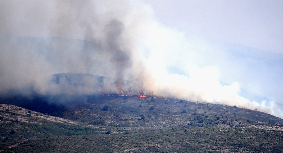 Flames burn grassland on the Tenderfoot Fire near Yarnell Thursday afternoon. (Les Stukenberg/The Daily Courier)