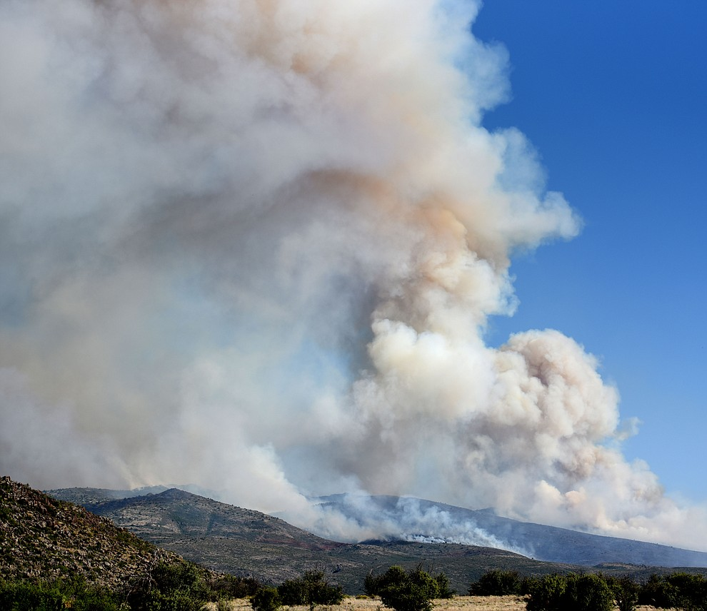 Smoke draws up into a plume on the Tenderfoot Fire near Yarnell Thursday afternoon. (Les Stukenberg/The Daily Courier)