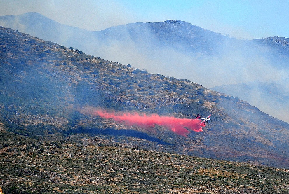 A heavy air tanker drops a load of retardent to create fire lines around the Tenderfoot Fire near Yarnell Thursday afternoon. (Les Stukenberg/The Daily Courier)