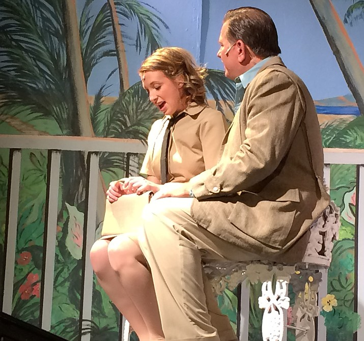 "Nellie Forbush (Caitlin Burd) discusses a possible future with a much-older Emile de Becque (Scott Neese) in PCA's production of ""South Pacific,"" directed by Frank Malle."