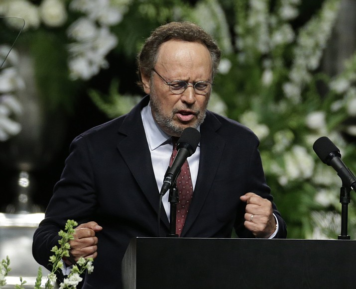Comedian Billy Crystal imitates Muhammad Ali during his memorial service, Friday, June 10, 2016, in Louisville, Ky.