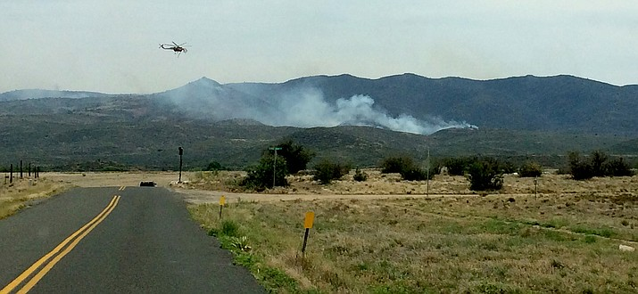 Two light and three heavy helicopters and two air attack fixed wing airplanes work at containing the Tenderfoot Fire in Yarnell Friday, June 10.