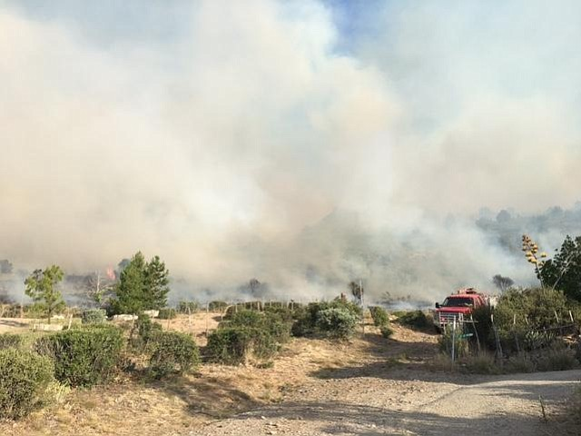 Fire crews work the edges of the Tenderfoot Fire near Yarnell this weekend.