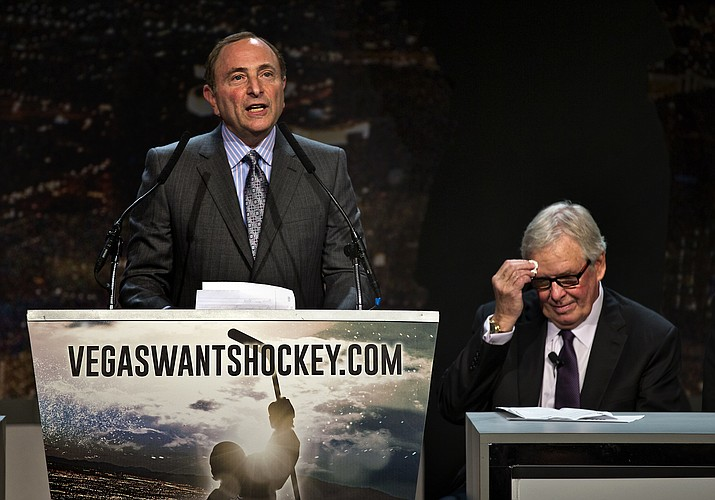"Gary Bettman, commissioner of the National Hockey League addresses the crowd as Bill Foley, chairman, Fidelity National Financial, Inc., Black Knight and FIS wipes his forehead during the 2015 ""Let's Bring Hockey to Las Vegas!"" press conference at the MGM Grand Ballroom in Las Vegas."