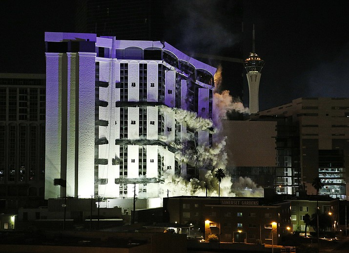 The Monaco Tower at the Riviera Hotel and Casino crumbles to the ground during a controlled demolition, Tuesday, June 14, 2016, in Las Vegas. The casino opened in 1955 and was closed last year to make room to expand the Las Vegas Convention Center.