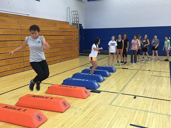 Chima Gomez (front), a rising senior at Chino Valley High School, works on agility drills with her teammates on the girls soccer team on Monday, June 13.