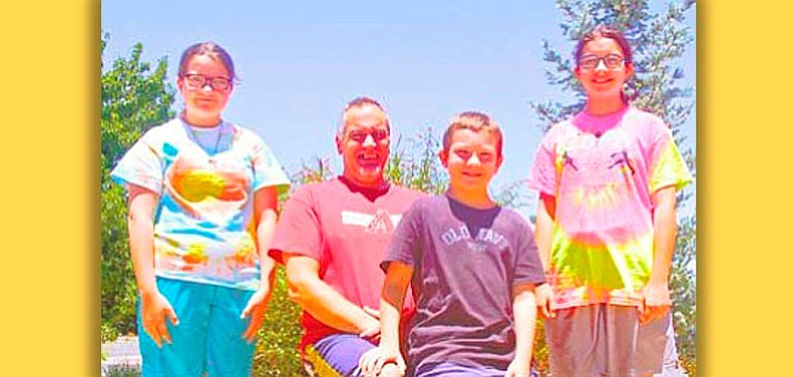Les Lee, a disabled father raising his three children, Patience, 13, Jobie, 12, and Richard, 11, rely on the Fair Start program to assist them and, as a result, they volunteer at the event to give back. This year's event is Saturday, July 25, at the Prescott United Methodist Church.