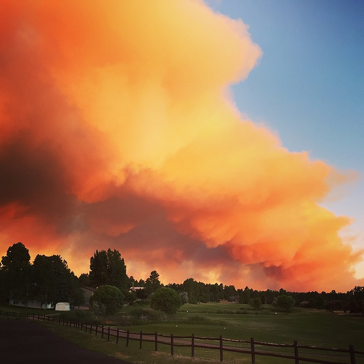 In this photo taken June 15, the day the blaze started, plumes of smoke are visible above a golf course in Show Low. This fire has expanded over the week to cover 26,739 acres and is at 40 percent containment.