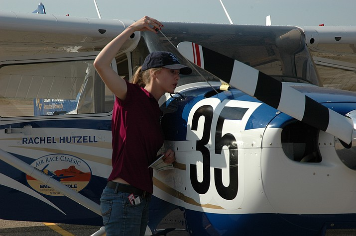 Rachel Hutzell, one of four Embry-Riddle Aeronautical University Prescott campus students participating in this year's Air Race Classic, checks her aircraft's oil.