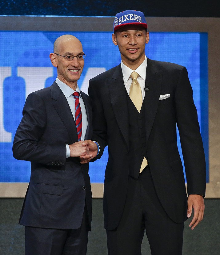 LSU's Ben Simmons poses for a photo with NBA Commissioner Adam Silver after being selected as the top pick by the Philadelphia 76ers during the NBA Draft on Thursday in New York.