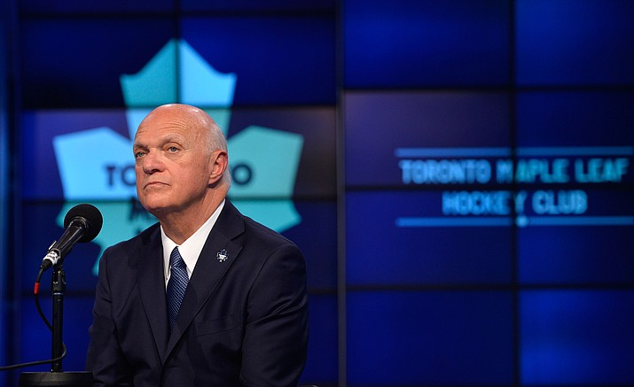 In this July 23, 2015 file photo, Lou Lamoriello speaks at a news conference in Toronto.  Lamoriello and Mike Babcock were hired a year ago to restore the Toronto Maple Leafs' long-lost luster. The next step in the once-iconic franchise's rebuilding plan takes place on Friday, June 24, 2016 when the Maple Leafs are expected to pin their hopes on Arizona-born center, Auston Matthews, with the first pick in the NHL draft.