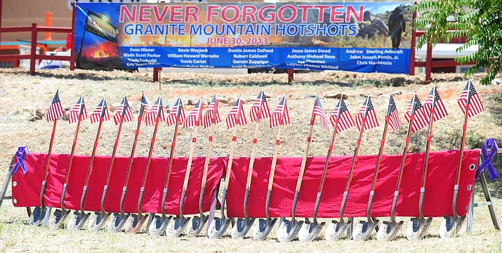 Flag-topped shovels with the names of the Granite Mountain Hotshots on the blades were part of the 2015 remembrance ceremony in Yarnell.