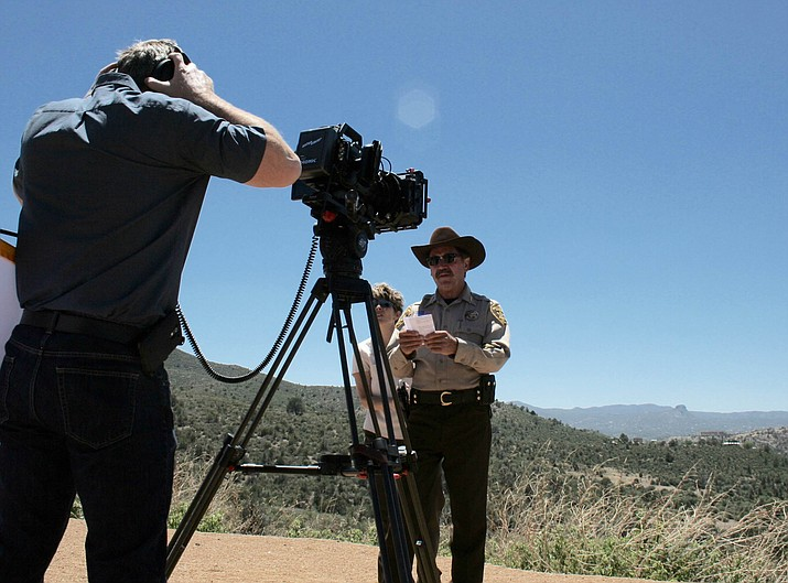 A Cable One crew films Yavapai County Sheriff Scott Mascher conveying a message about the dangers of distracted driving.