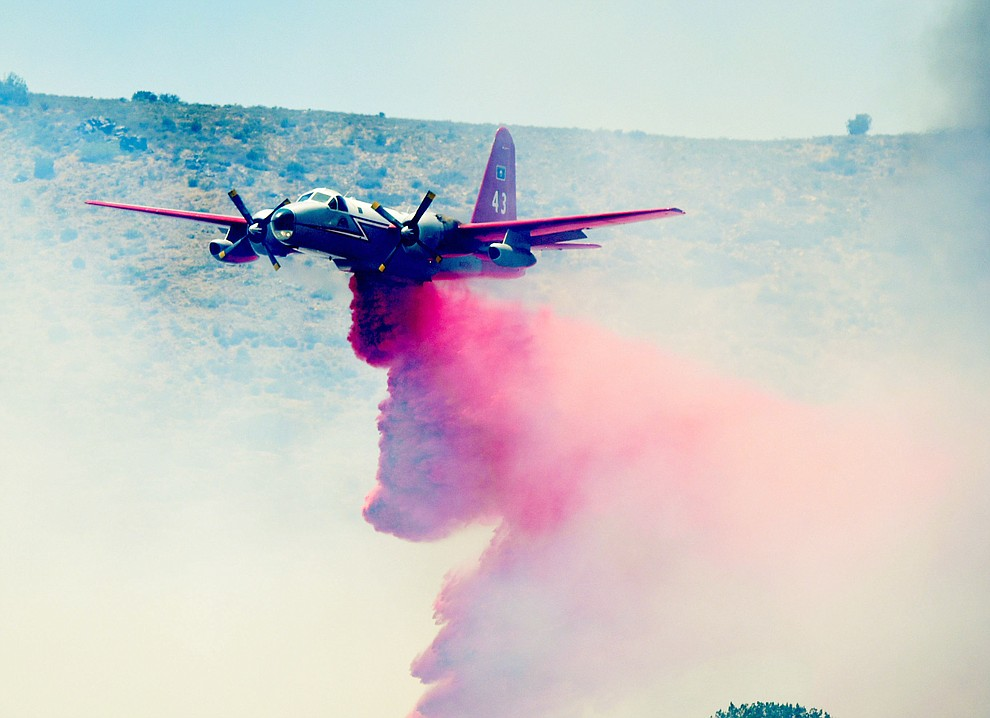 A heavy air tanker drops a load of retardent to create fire lines on the Bug Creek Fire near Cordes Lakes Tuesday afternoon. (Les Stukenberg/The Daily Courier)