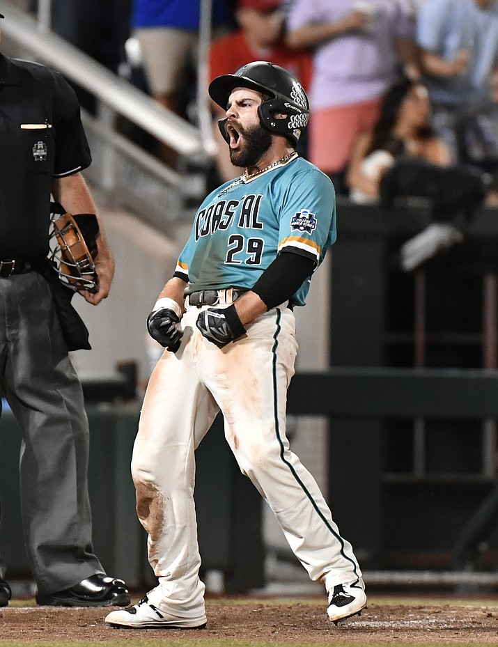 Coastal Carolina's Anthony Marks reacts to scoring on a Connor Owings single against Arizona in the eighth inning Tuesday.