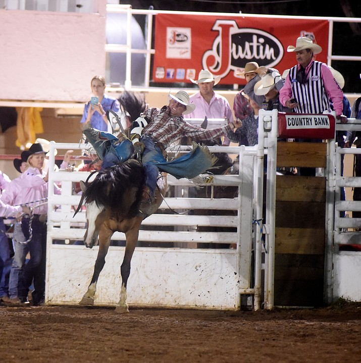 Heath Ford rides I'ma Be in the Bareback during the second round of the Prescott Frontier Days Rodeo Wednesday night. (Les Stukenberg/The Daily Courier)