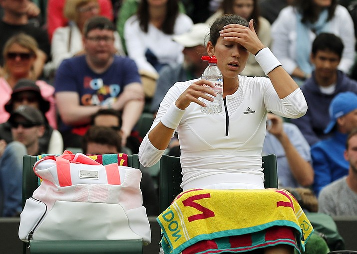 Garbine Muguruza of Spain has a drink during a break in her women's singles match against Jana Cepelova of Slovakia on day four of the Wimbledon Tennis Championships in London, Thursday, June 30.