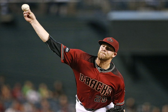 Arizona Diamondbacks' Archie Bradley throws against the Philadelphia Phillies during the first inning of a baseball game Wednesday, June 29, in Phoenix.