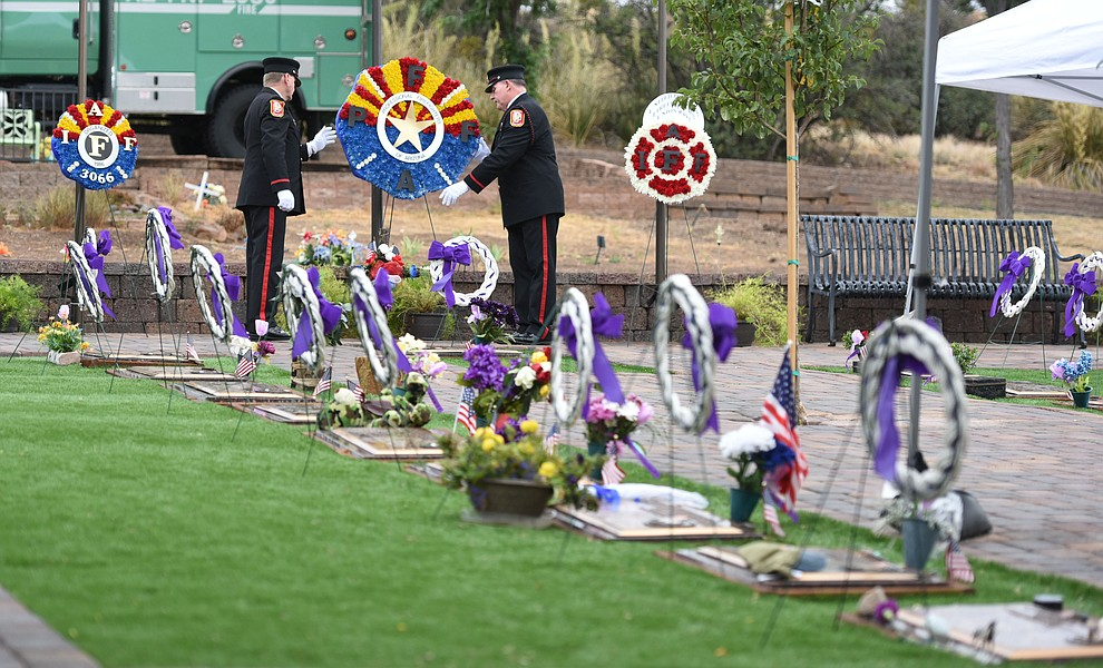 Honor Guard members place a wreath during a Celebration of Remembrance ceremony at the Arizona Pioneer's Home Cemetery on the third anniversary of the death's of the 19 Granite Mountain Hotshots while fighting the Yarnell Hill Fire. (Les Stukenberg/The Daily Courier)