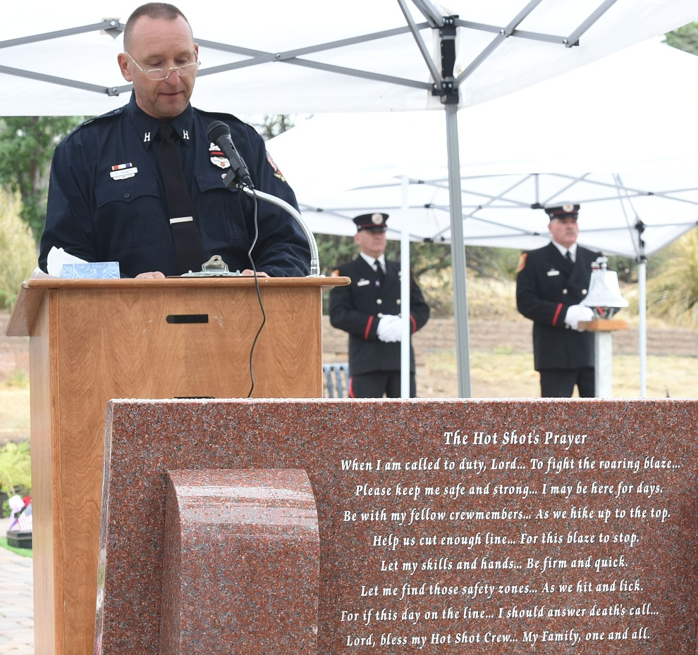 Tom Haney makes opening remarks during a Celebration of Remembrance ceremony at the Arizona Pioneer's Home Cemetery on the third anniversary of the death's of the 19 Granite Mountain Hotshots while fighting the Yarnell Hill Fire. (Les Stukenberg/The Daily Courier)