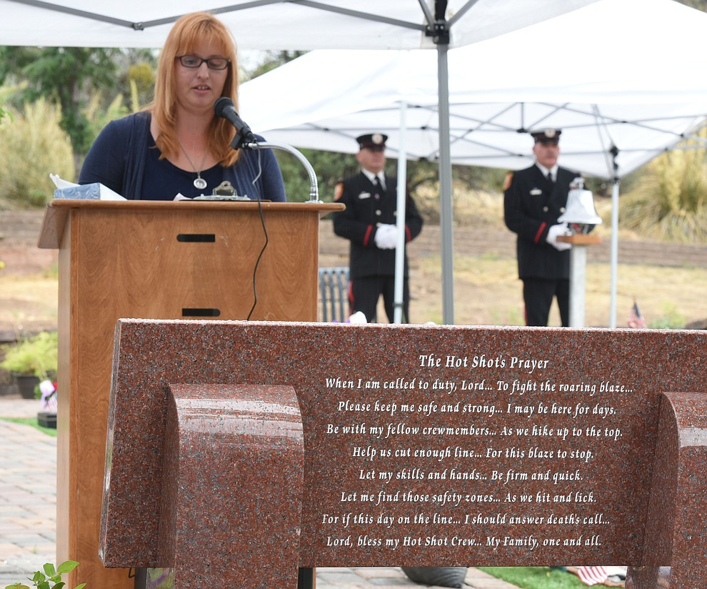 Trish Huston, author of the Hotshot's Prayer and wife of a Hotshot Superintendent, reads the prayer during a Celebration of Remembrance ceremony at the Arizona Pioneer's Home Cemetery on the third anniversary of the death's of the 19 Granite Mountain Hotshots while fighting the Yarnell Hill Fire. (Les Stukenberg/The Daily Courier)