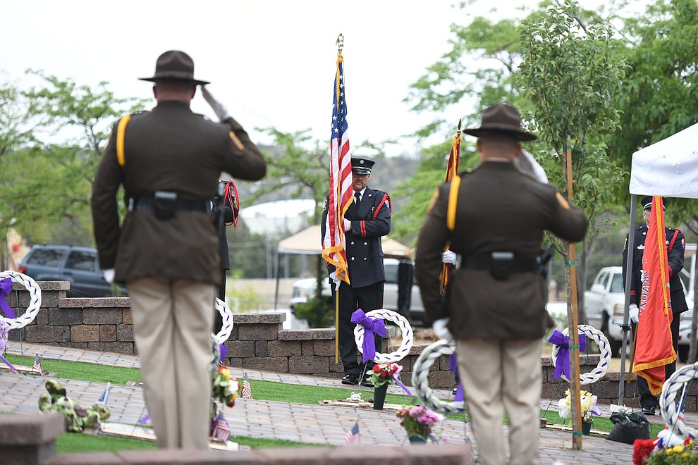 Honor Guard members present the colors during a Celebration of Remembrance ceremony at the Arizona Pioneer's Home Cemetery on the third anniversary of the death's of the 19 Granite Mountain Hotshots while fighting the Yarnell Hill Fire. (Les Stukenberg/The Daily Courier)