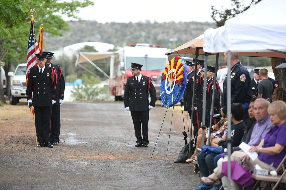 Honor Guard present the colors during a Celebration of Remembrance ceremony at the Arizona Pioneer's Home Cemetery on the third anniversary of the death's of the 19 Granite Mountain Hotshots while fighting the Yarnell Hill Fire. (Les Stukenberg/The Daily Courier)