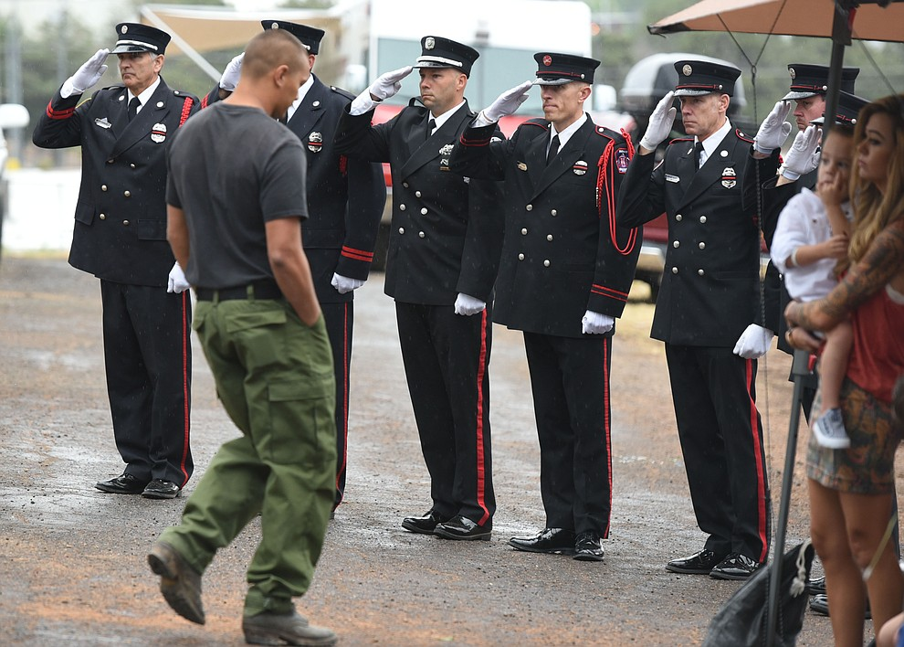 Honor Guard members salute after former GMHS Shane Arrollado read the names during a Celebration of Remembrance ceremony at the Arizona Pioneer's Home Cemetery on the third anniversary of the death's of the 19 Granite Mountain Hotshots while fighting the Yarnell Hill Fire. (Les Stukenberg/The Daily Courier)