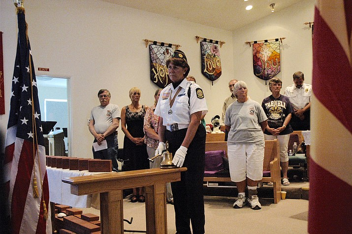 Jan Bowles of the American Legion Post 6 Honor Guard rings a bell as the names of each of the 19 fallen Granite Mountain Hotshots are read during a memorial ceremony in Yarnell Thursday, June 30.