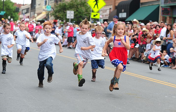 Five-year-old Grace Stillwell takes the win in her heat of the four to five year olds during the 33rd annual Whiskey Row Boot Race Saturday, July 4, 2015 in downtown Prescott.