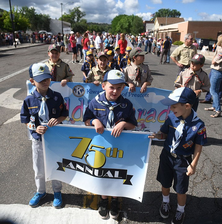 Cub Scouts lead the way during the 75th annual Kiwanis Kiddie Parade through downtown Prescott Friday morning. (Les Stukenberg/The Daily Courier)