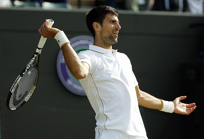 Novak Djokovic of Serbia gestures during his men's singles match against Sam Querrey of the U.S on day six of the Wimbledon Tennis Championships in London, Saturday, July 2.