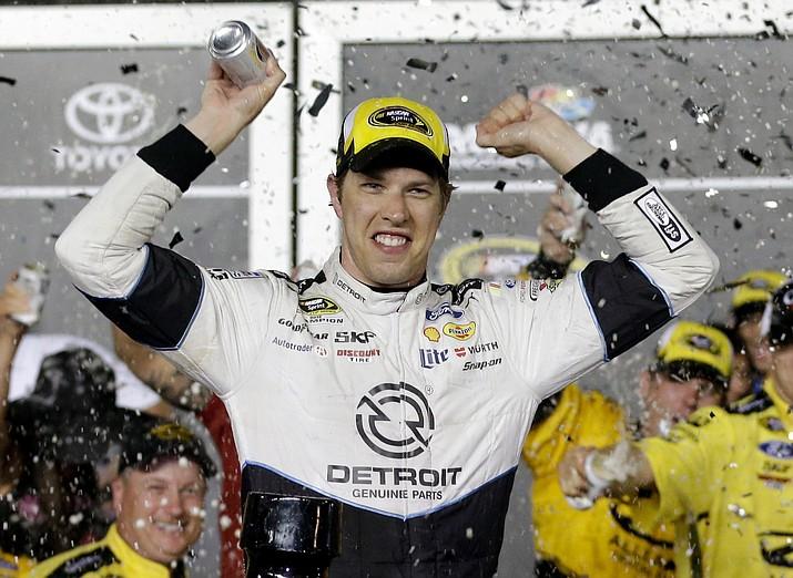 Brad Keselowski celebrates Saturday in Victory Lane after winning at Daytona International Speedway.