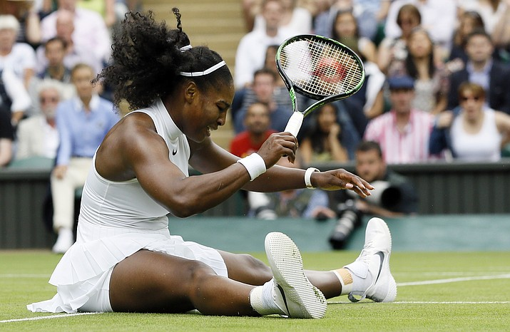 Serena Williams of the U.S slips over during her women's singles match against Svetlana Kuznetsova of Russia on day eight of the Wimbledon Tennis Championships in London, Monday, July 4.