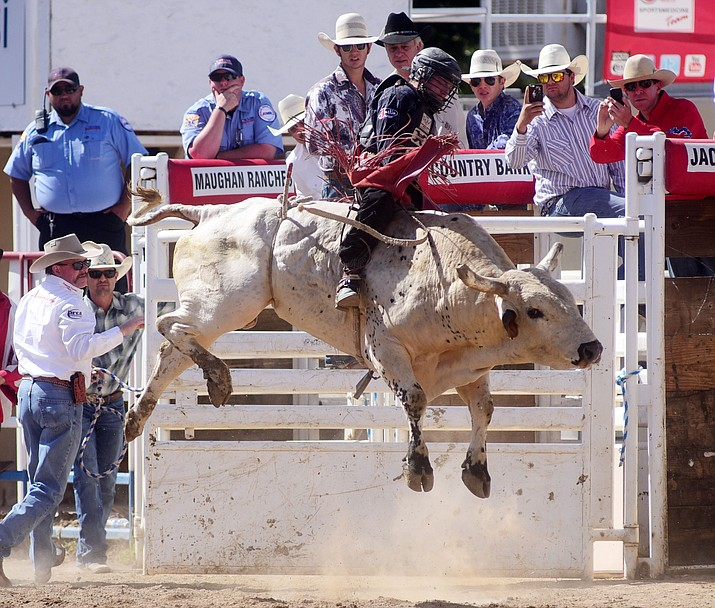 "Brennon Eldred rides Hello Dolly during the final performance of the 2016 Prescott Frontier Days Rodeo Sunday afternoon, July 4. The ""World's Oldest Rodeo"" closed with the bulls, with no one staying on for the required 8 seconds."