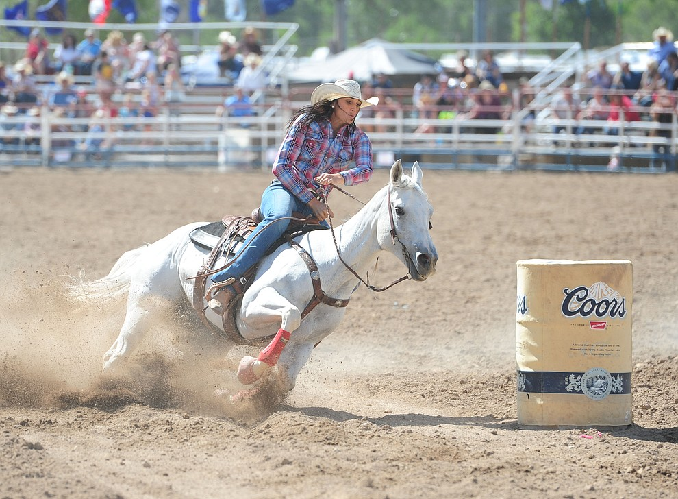 Erin Parsons turning the third barrel during the final performance of the 2016 Prescott Frontier Days Rodeo Monday afternoon. (Les Stukenberg/The Daily Courier)