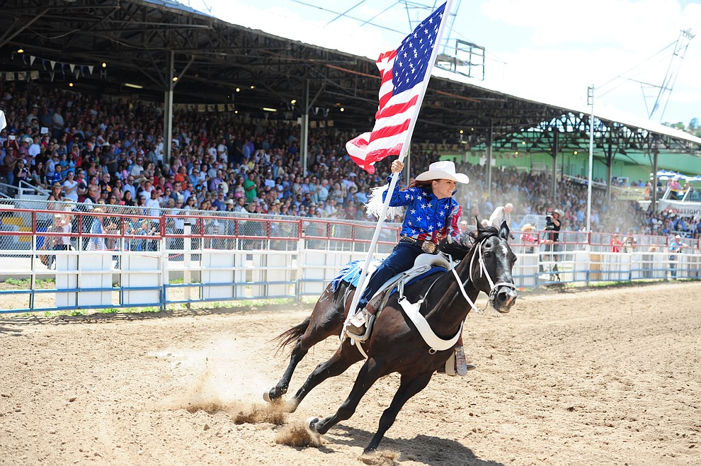 Bringing the American Flag into the arena during the final performance of the 2016 Prescott Frontier Days Rodeo Monday afternoon. (Les Stukenberg/The Daily Courier)