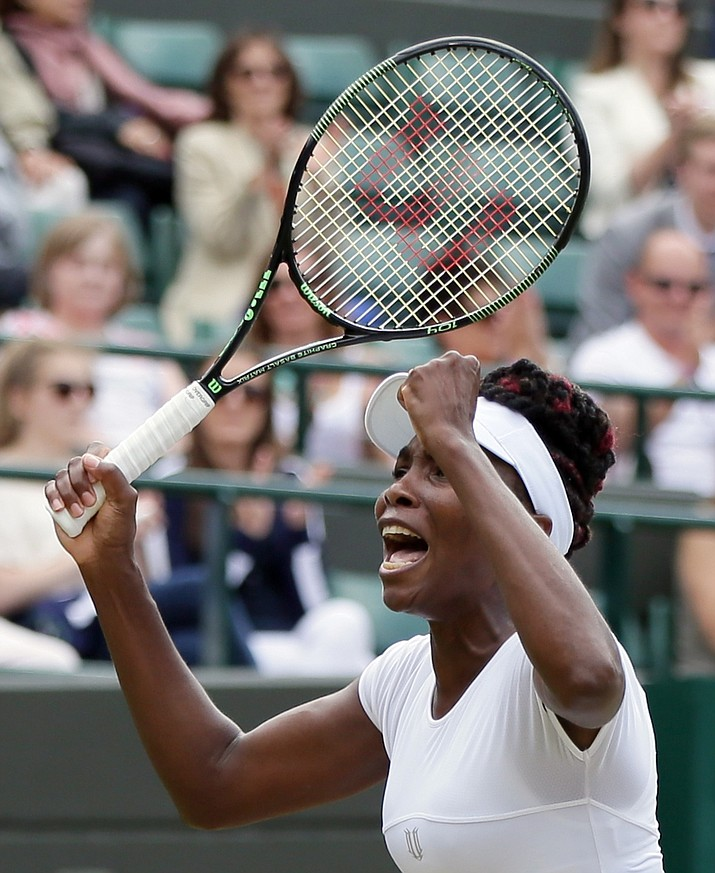 Venus Williams of the U.S celebrates after beating Yaroslava Shvedova of Kazahkstan at Wimbledon in London on Tuesday.