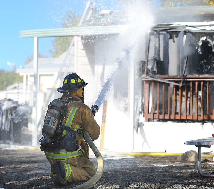Central Yavapai firefighters work a structure fire in the Orchard Ranch RV Park in Prescott Valley Friday morning. CYFD responded with four engines, water tender, utility, battalion chief, safety officer and two investigators. Prescott Valley Police also responded and ensured that adjacent homes were evacuated.