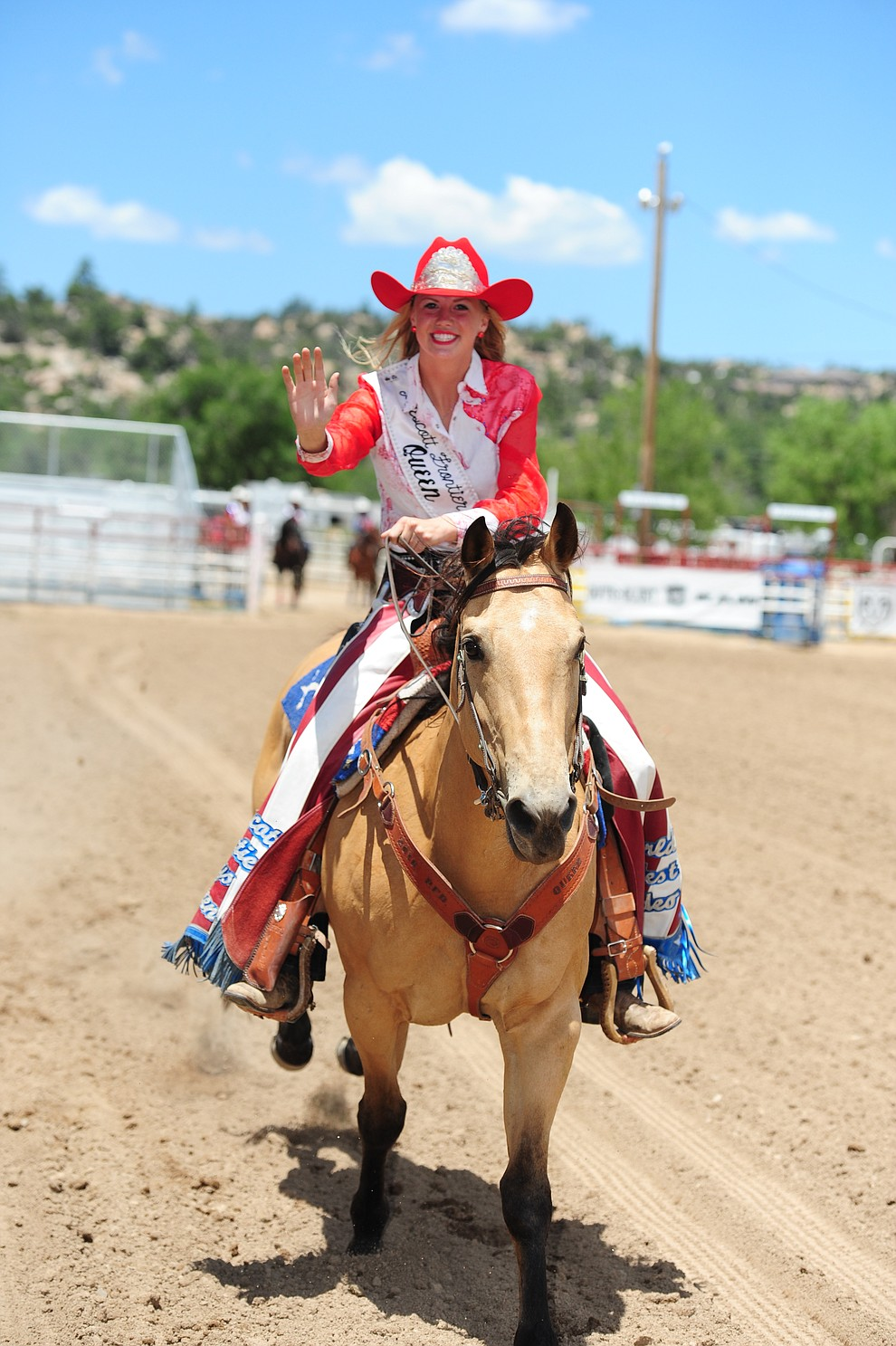 2016 Queen Bailey Anderson waves goodbye as the 2017 Prescott Frontier Days Royalty were crowned before the final performance of the 2016 Prescott Frontier Days Rodeo Monday afternoon. (Les Stukenberg/The Daily Courier)