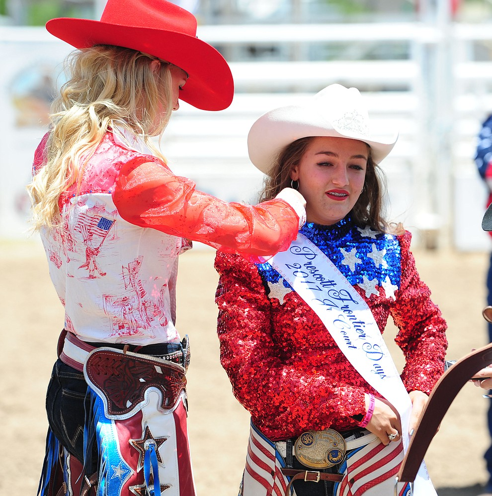 Emma Sigfried receives her Junior Court sash as the 2017 Prescott Frontier Days Royalty were crowned before the final performance of the 2016 Prescott Frontier Days Rodeo Monday afternoon. (Les Stukenberg/The Daily Courier)