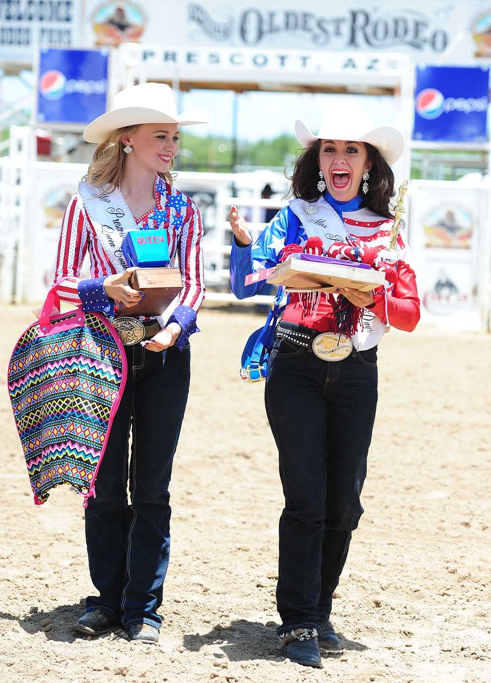 Elizabeth Siegfried watches as Giana DeMaria reacts after being named queen as the 2017 Prescott Frontier Days Royalty were crowned before the final performance of the 2016 Prescott Frontier Days Rodeo Monday afternoon. (Les Stukenberg/The Daily Courier)