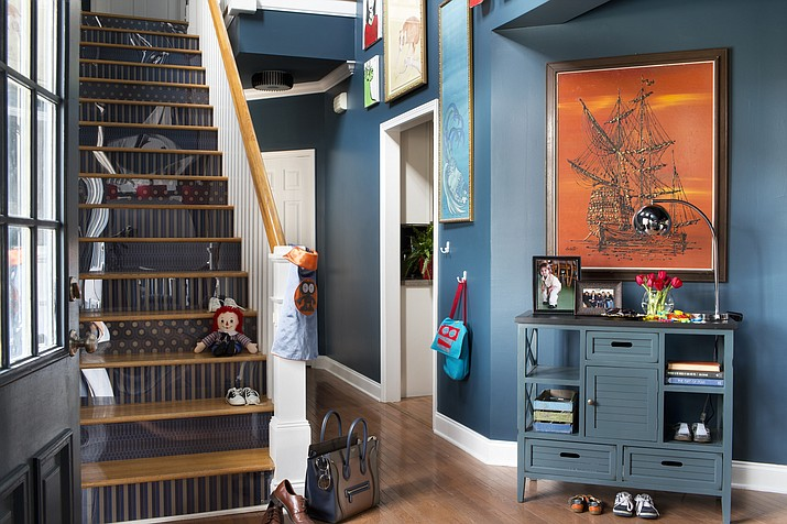 A staircase designed by Brian Patrick Flynn for HGTV.com. In this entryway the stair risers are wallpapered in contrasting patterns, bringing a dose of style and personality to a space that is often overlooked in many homes.