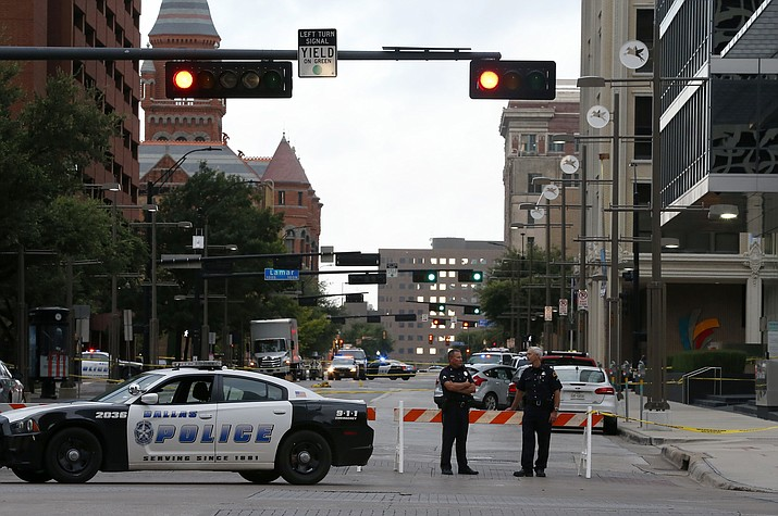 Dallas Police Department officers block Main Street near the El Centro College building in Dallas, Friday, July 8, 2016. Snipers opened fire on police officers in the heart of Dallas during protests over two recent fatal police shootings of black men.