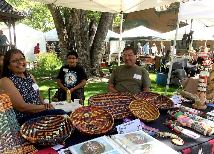 Iva, left, and L. Edward Honyestewa, Hopi, sell basketry made by Iva and wood and stone carvings made by Edward at the Prescott Indian Art Market at Sharlot Hall Museum this weekend.