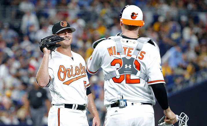 American League's Zach Britton, of the Baltimore Orioles, greets American League's Matt Wieters, of the Baltimore Orioles, after the MLB baseball All-Star Game, Tuesday, July 12, in San Diego. The American League won 4-2.