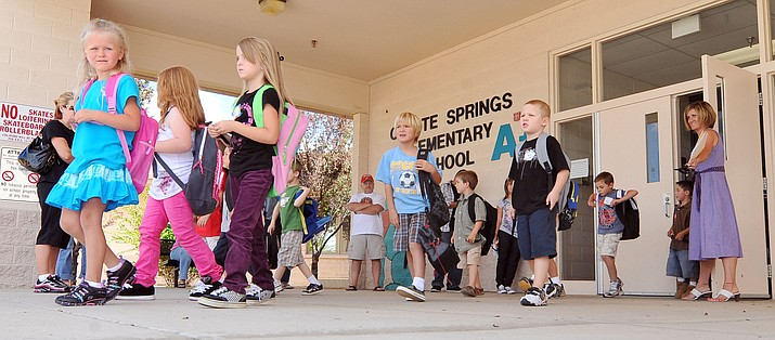 Students leave Coyote Springs Elementary School in Prescott Valley after a day of classes. The Humboldt Unified School District has 15 teaching positions it has been unable to fill this summer. (PNI file photo)