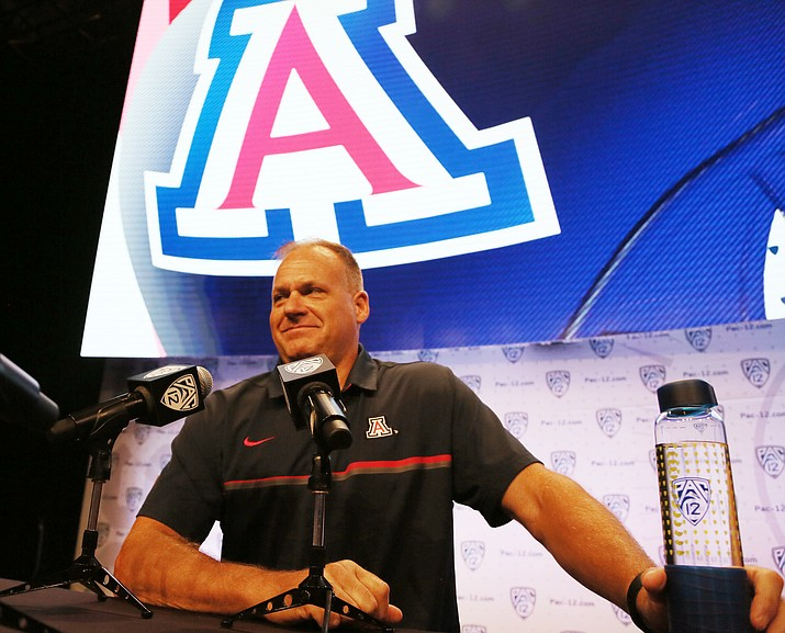 Arizona head coach Rich Rodriguez talks with reporters at the Pac-12 NCAA college football media day in Los Angeles Thursday, July 14.