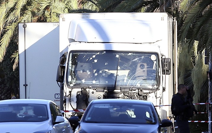 The truck which slammed into revelers late Thursday, July 14, is seen near the site of an attack in the French resort city of Nice, southern France, Friday, July 15, 2016. France has been stunned again as the large white truck mowed through a crowd of revelers gathered for a Bastille Day fireworks display in the Riviera city of Nice.