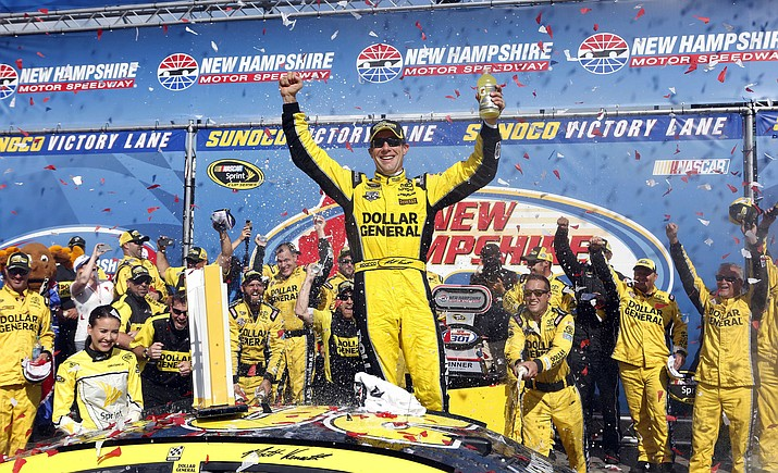 NASCAR driver Matt Kenseth celebrates after winning the New Hampshire 301 auto race at New Hampshire Motor Speedway Sunday, July 17, in Loudon, N.H.